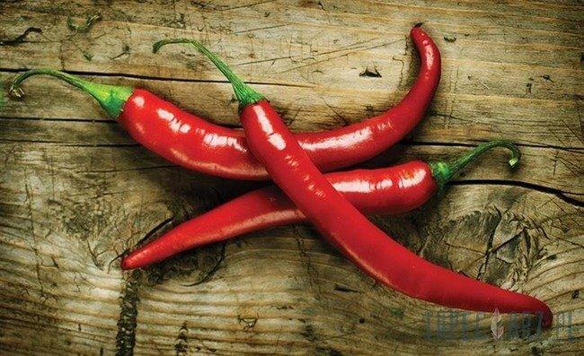 Fototapeta Papryczki chilli na deskach 2015